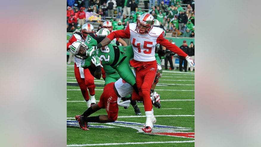 Marshall's Steward Butler (20) takes a hit from Western Kentucky's Brandon Leston (45) during an NCAA football game in Huntington, W.Va., Friday, Nov. 28, 2014. (AP Photo/Chris Tilley)
