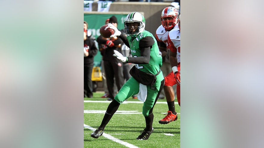 Marshall University's Rakeem Cato looks across the field to pass during an NCAA football game against Western Kentucky in Huntington, W. Va., Friday, Nov. 28, 2014. (AP Photo/Chris Tilley)