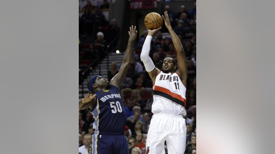 Portland Trail Blazers forward LaMarcus Aldridge, right, shoots against Memphis Grizzlies forward Zach Randolph during the first half of an NBA basketball game in Portland, Ore., Friday, Nov. 28, 2014.(AP Photo/Don Ryan)