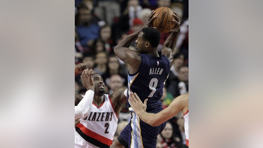 Memphis Grizzlies guard Tony Allen, right, looks to pass as Portland Trail Blazers guard Wesley Matthews defend during the first half of an NBA basketball game in Portland, Ore., Friday, Nov. 28, 2014.(AP Photo/Don Ryan)