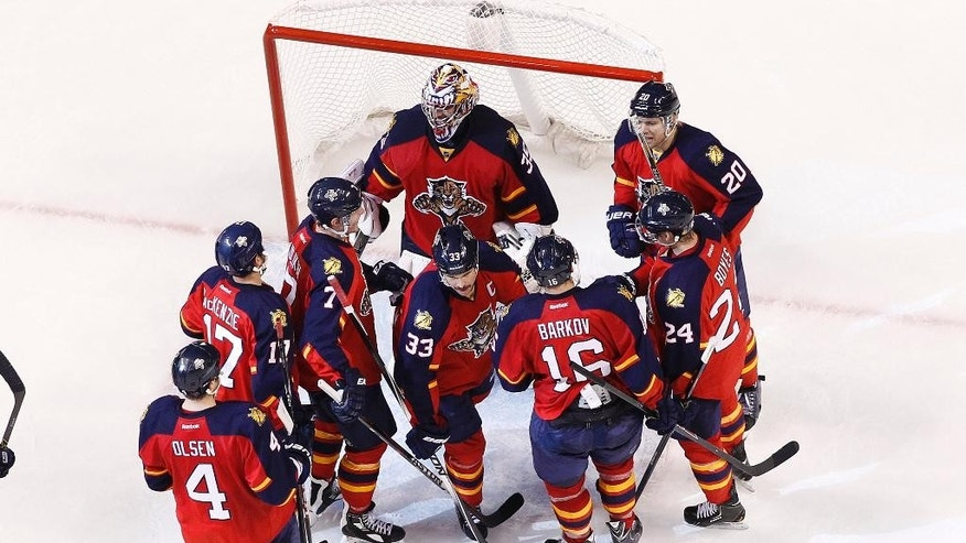Florida Panthers goaltender Al Montoya (35) is congratulated after the team defeated the Ottawa Senators in an NHL hockey game, Friday, Nov. 28, 2014, in Sunrise, Fla. The Panthers defeated the Senators 3-2. (AP Photo/Joel Auerbach)