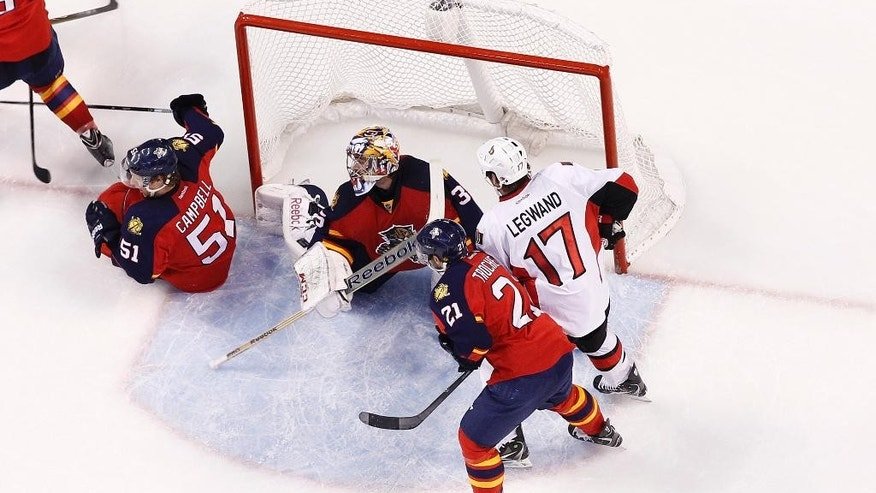 Florida Panthers goaltender Al Montoya (35) looks to his right after stopping a shot by Ottawa Senators forward David Legwand (17) during the third period of an NHL hockey game, Friday, Nov. 28, 2014, in Sunrise, Fla. The Panthers defeated the Senators 3-2. (AP Photo/Joel Auerbach)