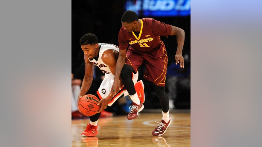Georgia's guard Kenny Gaines (12) recovers a loose ball against Minnesota's forward Carlos Morris (11) in the first half of an NIT Season Tip-off consolation NCAA college basketball game at Madison Square Garden, Friday, Nov. 28, 2014, in New York. (AP Photo/Kathy Kmonicek)
