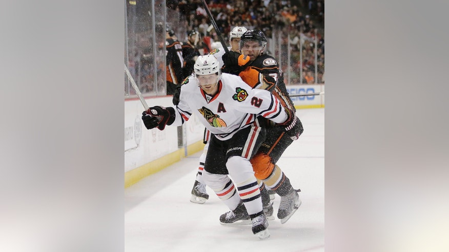 Chicago Blackhawks' Duncan Keith, front, and Anaheim Ducks' Jakob Silfverberg compete for control of the puck during the second period of an NHL hockey game Friday, Nov. 28, 2014, in Anaheim, Calif. (AP Photo/Jae C. Hong)