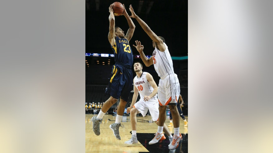 La Salle guard Khalid Lewis (23) shoots against Virginia guard Malcolm Brogdon (15) as center Mike Tobey (10) in the first half of their NCAA college basketball game during the Barclays Center Classic, Friday, Nov. 28, 2014, in New York. (AP Photo/John Minchillo)