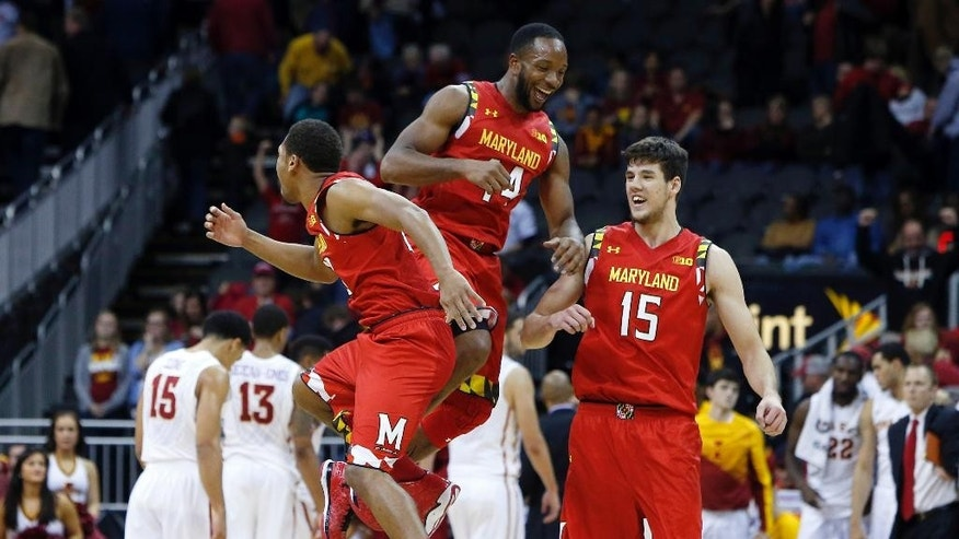 Maryland's Richaud Pack, left, Dez Wells (44) and Michal Cekovsky (15) celebrate a 72-63 win over Iowa State in an NCAA college basketball game Tuesday, Nov. 25, 2014, in Kansas City, Mo. (AP Photo/Ed Zurga)