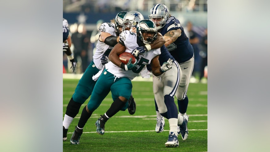 Philadelphia Eagles running back LeSean McCoy (25) is tackled by Dallas Cowboys outside linebacker Bruce Carter (54) during the first half of an NFL football game Thursday, Nov. 27, 2014, in Arlington, Texas. (AP Photo/The Waco Tribune Herald, Jose Yau)