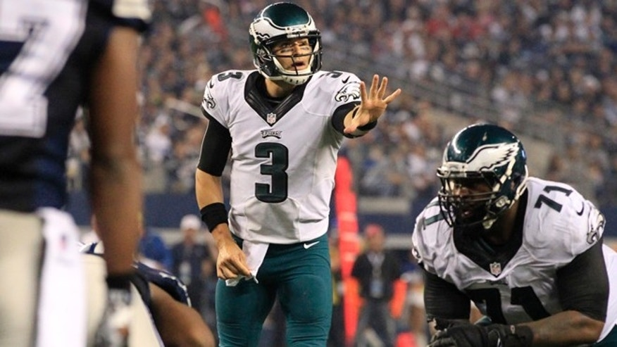 Philadelphia Eagles' Mark Sanchez (3) directs his offense as Jason Peters (71) prepares to guard against the rush from the Dallas Cowboys during the second half of an NFL football game, Thursday, Nov. 27, 2014, in Arlington, Texas. The Eagles won 33-10. (AP Photo/John F. Rhodes)
