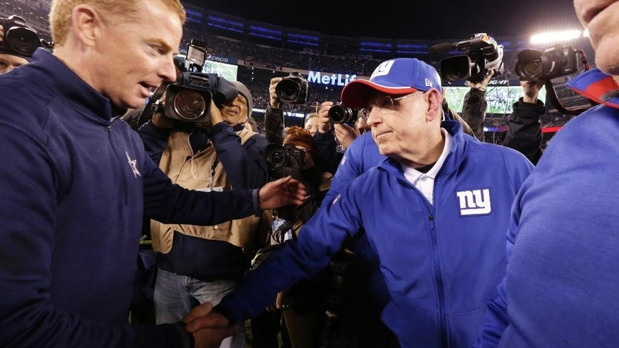 Dallas Cowboys head coach Jason Garrett, left, greets New York Giants head coach Tom Coughlin after the Cowboys beat the Giants 31-28 in an NFL football game, Sunday, Nov. 23, 2014, in East Rutherford, N.J. (AP Photo/Julio Cortez)