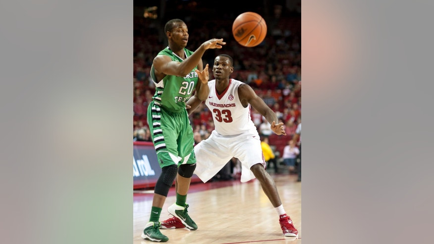 Arkansas' Moses Kingsley (33) defends North Texas' Muhammed Ahmed (20) in the first half of an NCAA college basketball game in Fayetteville, Ark., Friday, Nov. 28, 2014. (AP Photo/Sarah Bentham)