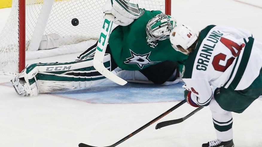 Minnesota Wild center Mikael Granlund (64) shoots the puck past Dallas Stars goalie Kari Lehtonen (32) for a goal in the second period of an NHL hockey game, Friday, Nov. 28, 2014, in Dallas. (AP Photo/Brandon Wade)
