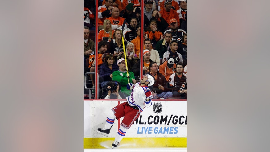 New York Rangers' Martin St. Louis celebrates after scoring during the second period of an NHL hockey game against the Philadelphia Flyers, Friday, Nov. 28, 2014, in Philadelphia. (AP Photo/Matt Slocum)