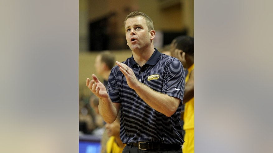 Marquette head coach Steve Wojciechowski applauds during the second half of an NCAA college basketball game against the Michigan State in Lake Buena Vista, Fla., Friday, Nov. 28, 2014. (AP Photo/Reinhold Matay)