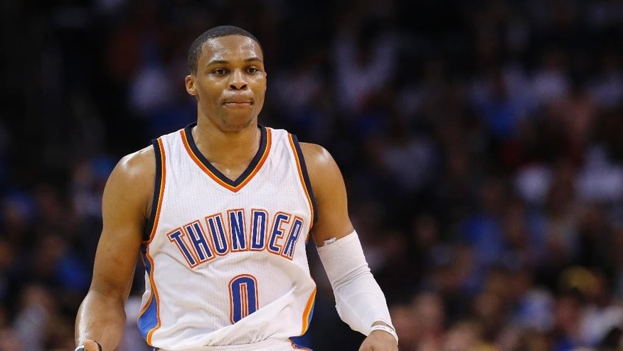 Oklahoma City Thunder guard Russell Westbrook gestures after hitting a three-point basket in the second quarter of an NBA basketball game against the New York Knicks in Oklahoma City, Friday, Nov. 28, 2014. (AP Photo/Sue Ogrocki)