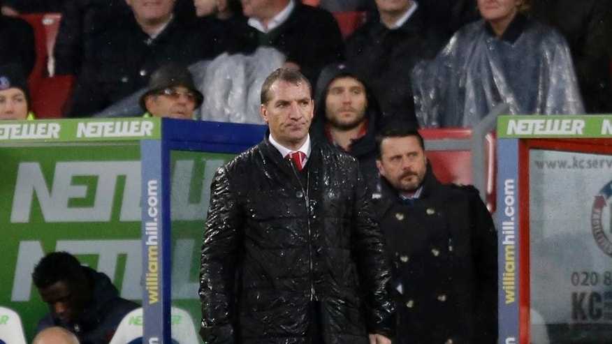 Liverpool's manager Brendan Rodgers watches during the English Premier League soccer match between Crystal Palace and Liverpool at Selhurst Park stadium in London, Sunday, Nov. 23, 2014.  (AP Photo/Matt Dunham)