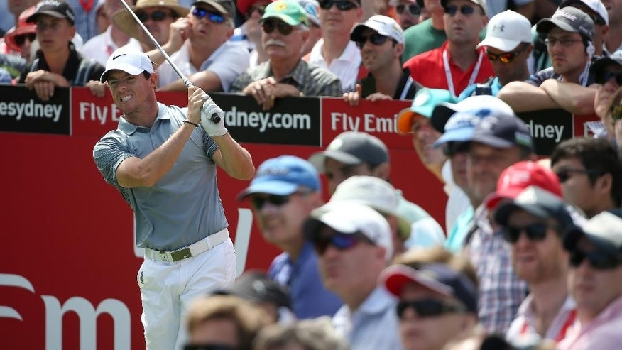 Northern Ireland's Rory McIlroy grimaces after his tee shot at the 14th hole during the second round of the Australian Open Golf championship in Sydney, Friday, Nov. 28, 2014. (AP Photo/Rick Rycroft)