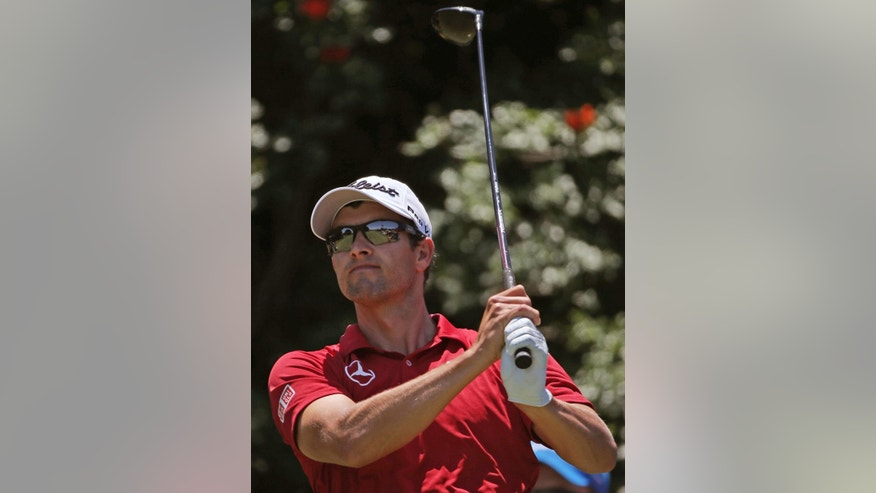 Australia's Adam Scott watches his tee shot on the 6th hole during the third round of the Australian Open Golf championship in Sydney, Saturday, Nov. 29, 2014. (AP Photo/Rick Rycroft)