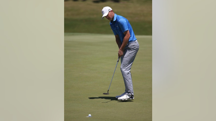 Jordan Spieth of the US makes a birdie putt on the 6th hole during the final round of the Australian Open golf championship in Sydney, Sunday, Nov. 30, 2014. Spieth started the day co-leader at 5 under. (AP Photo/Rick Rycroft)