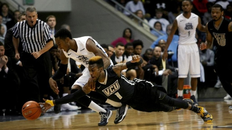 Virginia Commonwealth's JeQuan Lewis (1) and Old Dominion's Keenan Palmore (3) battle for a loose ball during the first half of their NCAA college basketball game, Saturday, Nov. 29, 2014, at the Constant Center in Norfolk, Va. (AP Photo/Jason Hirschfeld)