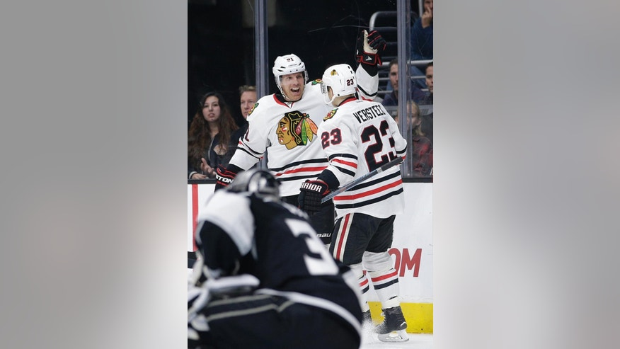 Chicago Blackhawks' Brad Richards, left, celebrates his goal with Kris Versteeg during the first period of an NHL hockey game against the Los Angeles Kings Saturday, Nov. 29, 2014, in Los Angeles. (AP Photo/Jae C. Hong)