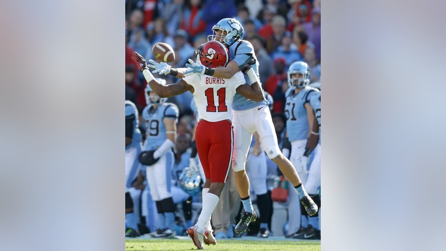 North Carolina State's Juston Burris (11) and North Carolina's Mack Hollins reach for a pass intended for Hollins during the first half of an NCAA college football game in Chapel Hill, N.C., Saturday, Nov. 29, 2014. The pass fell incomplete. (AP Photo/Gerry Broome)