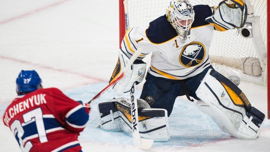 Montreal Canadiens' Alex Galchenyuk shoots against Buffalo Sabres goaltender Jhonas Enroth during second-period NHL hockey game action in Montreal, Saturday, Nov. 29, 2014. (AP Photo/The Canadian Press, Graham Hughes)