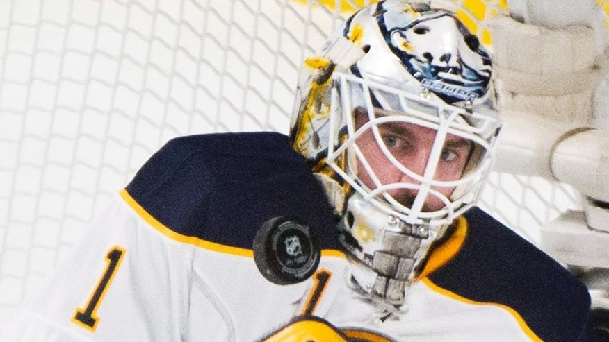 Buffalo Sabres goaltender Jhonas Enroth makes a save against the Montreal Canadiens during second-period NHL hockey game action in Montreal, Saturday, Nov. 29, 2014. (AP Photo/The Canadian Press, Graham Hughes)