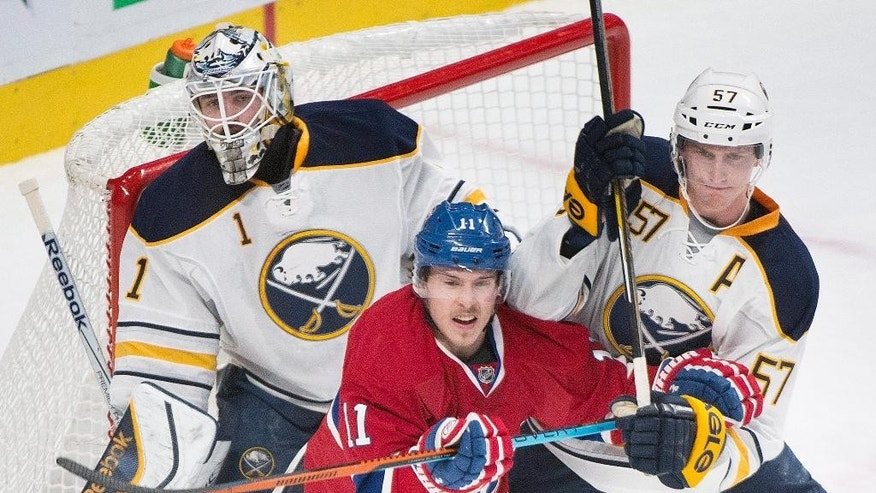 Buffalo Sabres goaltender Jhonas Enroth (1) watches the play as teammate Tyler Myers, right, defends against Montreal Canadiens' Brendan Gallagher during first-period NHL hockey game action in Montreal, Saturday, Nov. 29, 2014. (AP Photo/The Canadian Press, Graham Hughes)