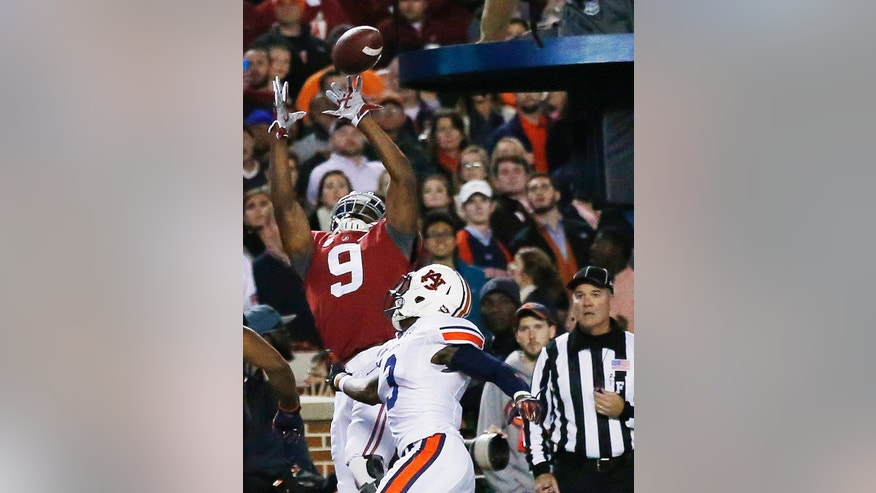Alabama wide receiver Amari Cooper (9) prepares to make the catch for a touchdown against Auburn defensive back Mack VanGorder (13) during the first half of the Iron Bowl NCAA college football game, Saturday, Nov. 29, 2014, in Tuscaloosa, Ala. (AP Photo/Brynn Anderson )