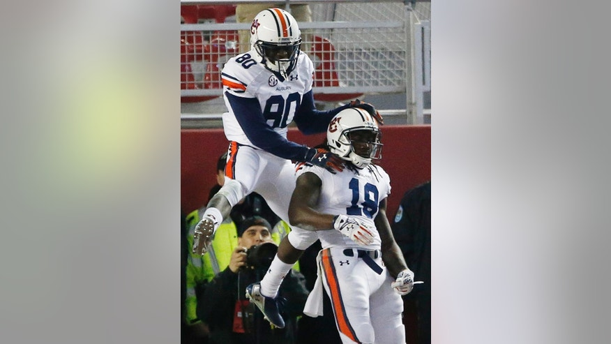 Auburn wide receiver Sammie Coates (18) celebrates his touchdown with Auburn wide receiver Marcus Davis (80) during the first half of the Iron Bowl NCAA college football game against Alabama, Saturday, Nov. 29, 2014, in Tuscaloosa, Ala. (AP Photo/Brynn Anderson )