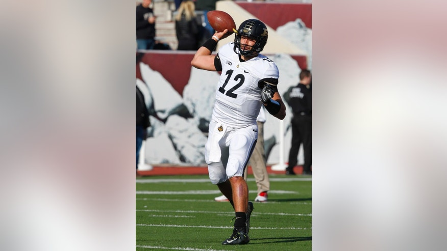 Purdue quarterback Austin Appleby (12) throws during warm-ups before the start of an NCAA college football game against Indiana in Bloomington, Ind., Saturday, Nov. 29, 2014. (AP Photo/John Sommers II)