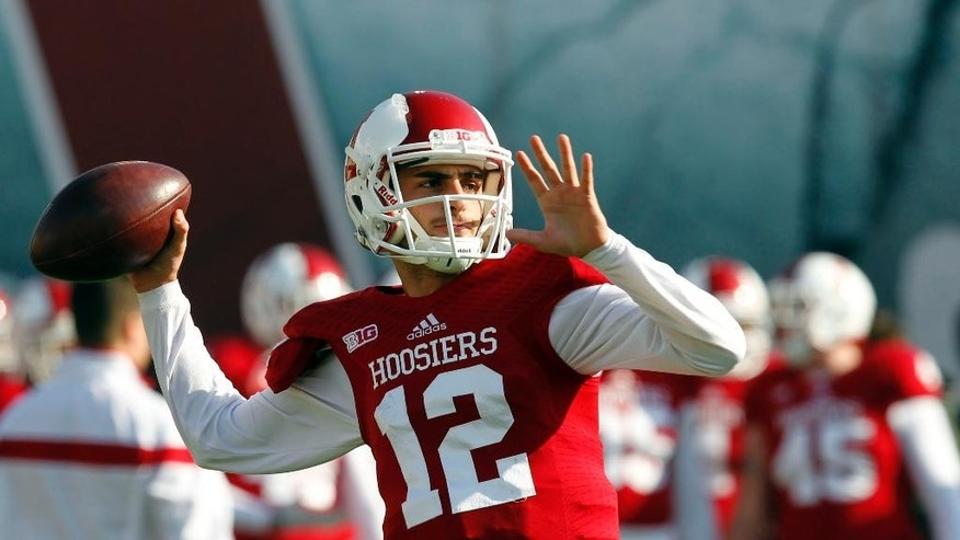 Indiana quarterback Zander Diamont (12) throws during warm-ups before the start of an NCAA college football game against the Purdue, in Bloomington, Ind., Saturday, Nov. 29, 2014. (AP Photo/John Sommers II)