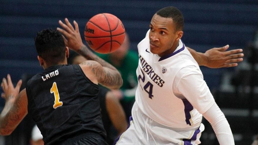 Long Beach State guard Tyler Lamb (1) has his pass batted down by Washington center Robert Upshaw (24) in the first half of an NCAA college basketball semifinal game at the Wooden Legacy tournament in Fullerton, Calif., Friday, Nov. 28, 2014. (AP Photo/Alex Gallardo)