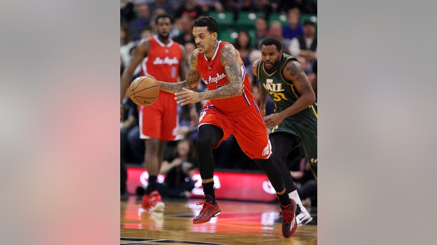Los Angeles Clippers' forward Matt Barnes (22) heads down court ahead of Utah Jazz's forward Trevor Booker (33) after recovering a loose ball in the first half during an NBA basketball game Saturday, Nov. 29, 2014, in Salt Lake City.  (AP Photo/Steve Wilson)