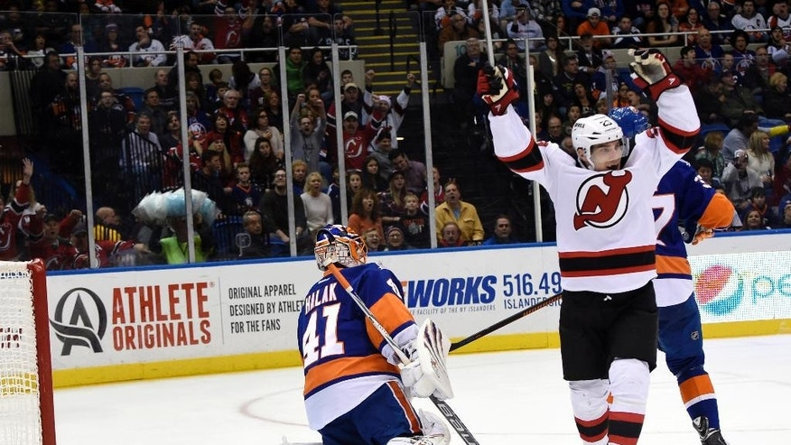 New Jersey Devils left wing Mike Cammalleri, right, celebrates right wing Damien Brunner's goal against New York Islanders goalie Jaroslav Halak (41) in the first period of an NHL hockey game at Nassau Coliseum on Saturday, Nov. 29, 2014, in Uniondale, N.Y. (AP Photo/Kathy Kmonicek)