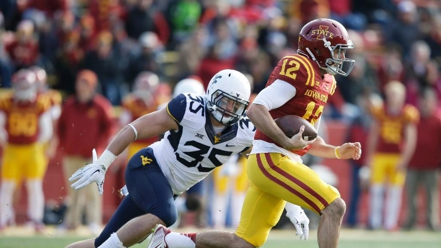 Iowa State quarterback Sam B. Richardson (12) runs from West Virginia linebacker Nick Kwiatkoski (35) during the first half of an NCAA college football game, Saturday, Nov. 29, 2014, in Ames, Iowa. (AP Photo/Charlie Neibergall)