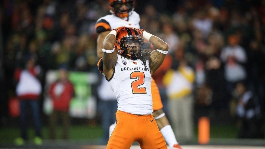 Oregon State defender Steven Nelson reacts after missing an interception during the first quarter of an NCAA college football game against Oregon in Corvallis, Or., Saturday, Nov. 29, 2014. (AP Photo/Troy Wayrynen)