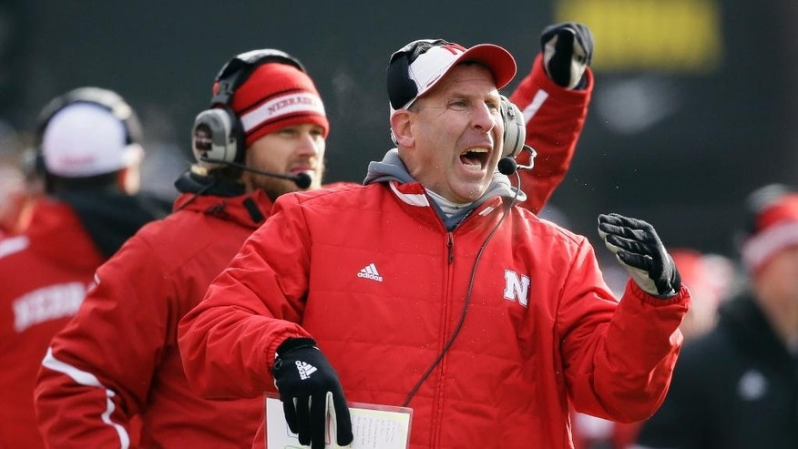 Nebraska head coach Bo Pelini reacts during the second half of an NCAA college football game against Iowa, Friday, Nov. 28, 2014, in Iowa City, Iowa. Nebraska won 37-34 in overtime. (AP Photo/Charlie Neibergall)