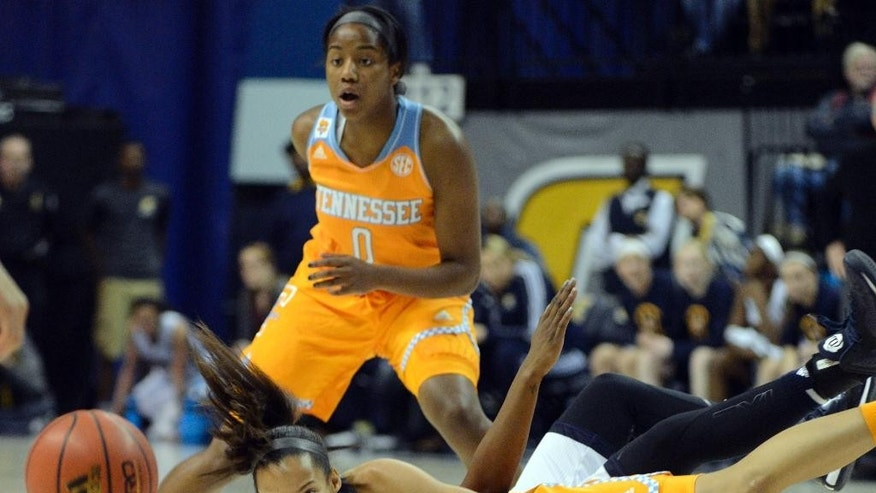 Tennessee center Nia Moore (1) goes for a loose ball against Chattanooga in the second half of an NCAA college basketball game Wednesday, Nov. 26, 2014, in Chattanooga, Tenn. Chattanooga Tennessee won 67-63.  (AP Photo/Billy Weeks)
