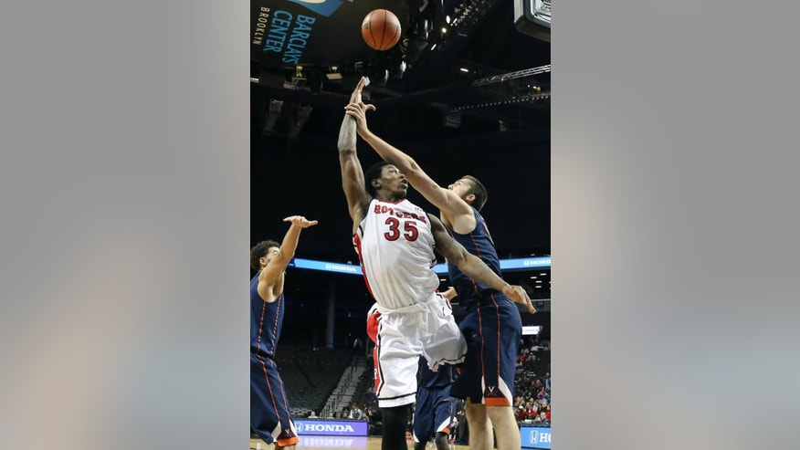 Rutgers forward/center Greg Lewis (35) scores while drawing a foul from Virginia forward/center Mike Tobey, right, in the first half of an NCAA college basketball game, the championship game of the Barclays Center Classic, Saturday, Nov. 29, 2014, in New York. (AP Photo/John Minchillo)