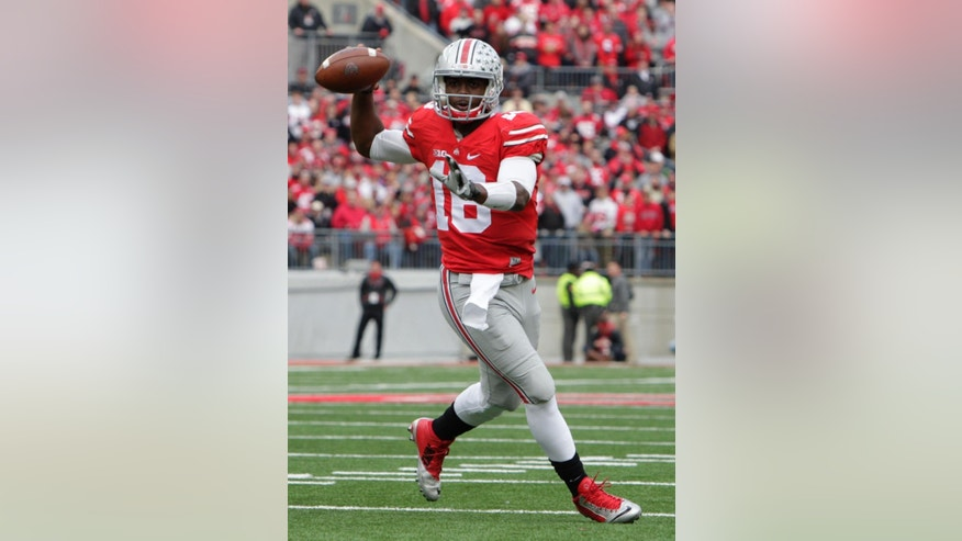 Ohio State quarterback J.T. Barrett throws a pass against Michigan during the first quarter of an NCAA college football game Saturday, Nov. 29, 2014, in Columbus, Ohio. (AP Photo/Jay LaPrete)