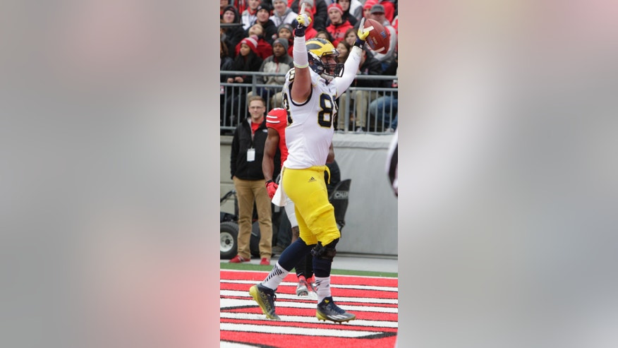 Michigan tight end Jake Butt celebrates his touchdown against Ohio State during the first quarter of an NCAA college football game Saturday, Nov. 29, 2014, in Columbus,  Ohio. (AP Photo/Jay LaPrete)