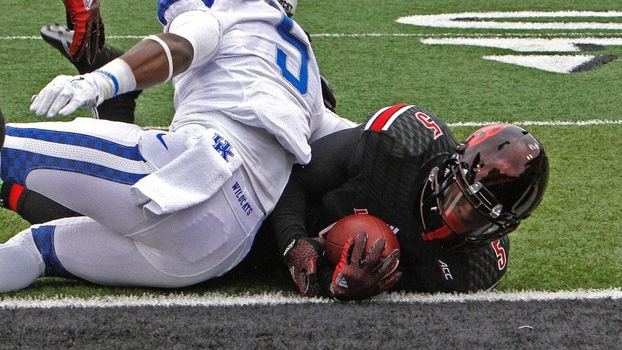 Louisville's Michael Dyer, right, scores a touchdown through the defense of Kentucky's Ashely Lowery during the first half of an NCAA college football game Saturday, Nov. 29, 2014, in Louisville, Ky. (AP Photo/Garry Jones)