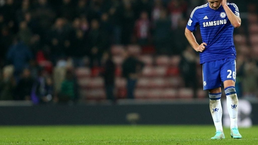 Chelsea's captain John Terry stands dejected after a draw against Sunderland at the end of  their English Premier League soccer match at the Stadium of Light, Sunderland, England, Saturday, Nov. 29, 2014. (AP Photo/Scott Heppell)