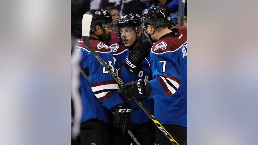 Colorado Avalanche center Daniel Briere (48) is congratulated by teammates Maxime Talbot (25) and John Mitchell (7) after scoring a goal against the Dallas Stars during the first period of an NHL hockey game Saturday, Nov. 29, 2014, in Denver. (AP Photo/Jack Dempsey)