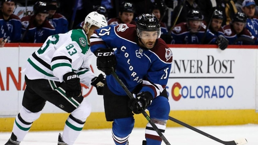 Colorado Avalanche center Maxime Talbot (25) moves the puck past Dallas Stars right wing Ales Hemsky (83) during the second period of an NHL hockey game Saturday, Nov. 29, 2014, in Denver. (AP Photo/Jack Dempsey)