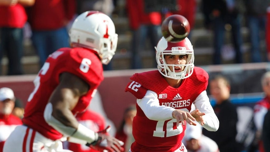 Indiana quarterback Zander Diamont (12) pitches the football to Tevin Coleman (6) during the first half of an NCAA college football game against Purdue, in Bloomington, Ind., Saturday Nov. 29, 2014. (AP Photo/John Sommers II)