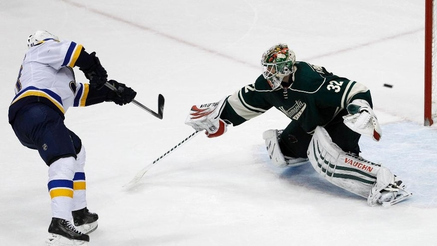 The game-winning shot by St. Louis Blues right wing Vladimir Tarasenko, left, of Russia, gets past Minnesota Wild goalie Niklas Backstrom (32), of Finland, during a shootout in an NHL hockey game in St. Paul, Minn., Saturday, Nov. 29, 2014. The Blues won 3-2 in a shootout. (AP Photo/Ann Heisenfelt)