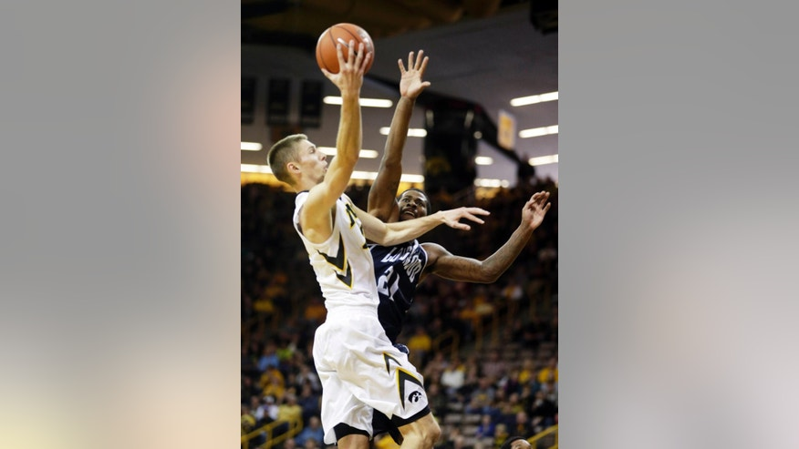 Iowa's Jarod Uthoff, left, goes to the hoop against Longwood's Shaquille Johnson during the first half of their NCAA college basketball game Saturday, Nov. 29, 2014, in Iowa City, Iowa. (AP Photo/Jim Slosiarek)