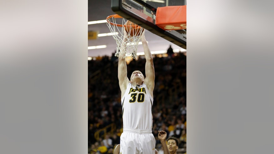 Iowa's Aaron White dunks during the first half of their NCAA college basketball game against Longwood on Saturday, Nov. 29, 2014, in Iowa City, Iowa. (AP Photo/Jim Slosiarek)